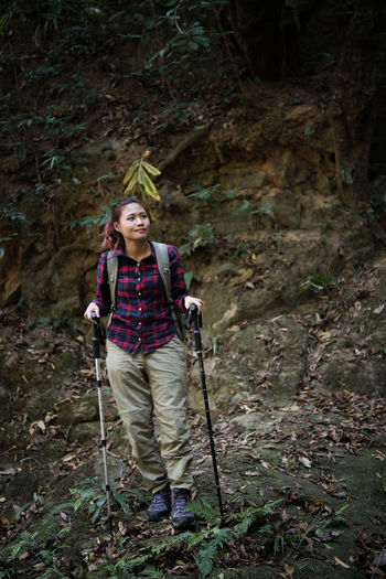 Full Length Of A Young Woman In Forest