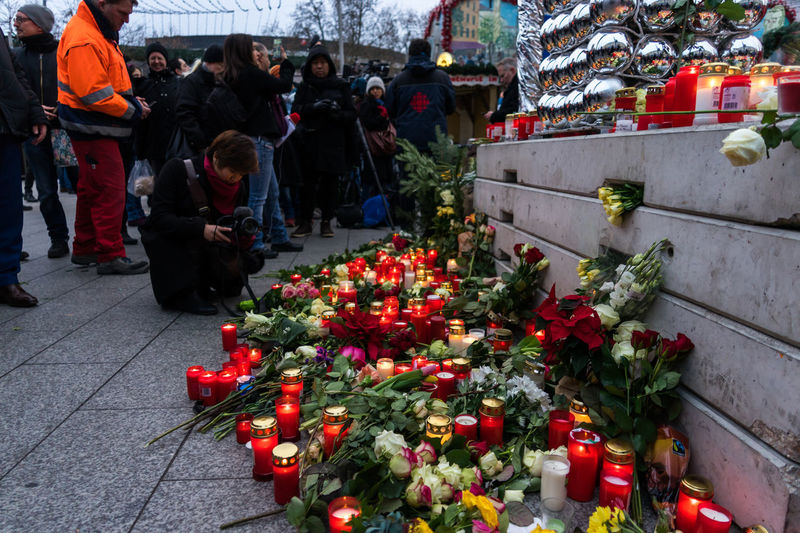 Breitscheidplatz in Berlin Charlottenburg the day after the terrorist attack Adult Adults Only Berlin Charlottenburg  City Day Flower Freshness Illuminated Investigation Media Mourning Nature Outdoors People Police Press Red Terrorist Terrorist Attack