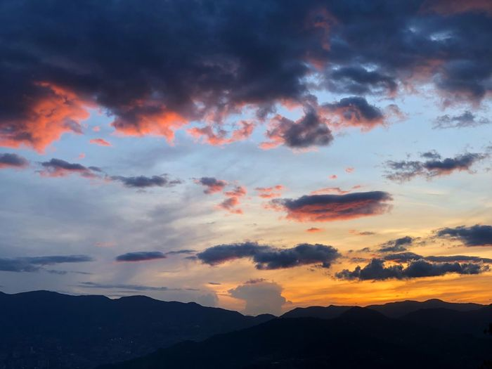 Sky Cloud - Sky Beauty In Nature Sunset Scenics - Nature Tranquility Tranquil Scene Mountain Mountain Range Silhouette Dramatic Sky Outdoors