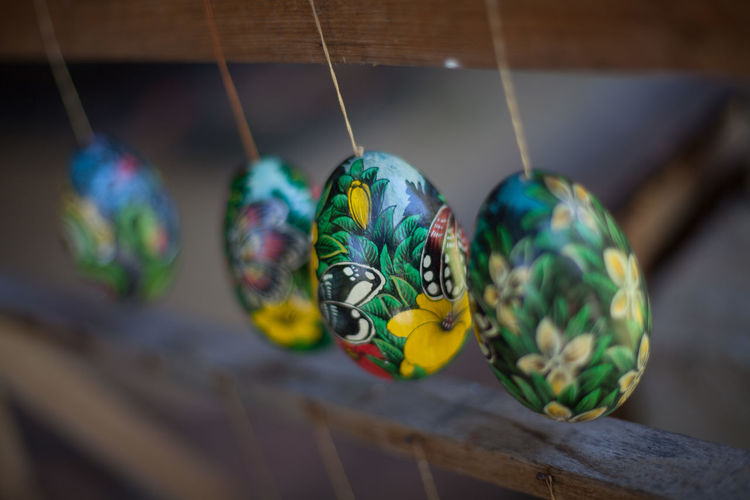 Designed Easter Eggs Hanging On Wooden Railing