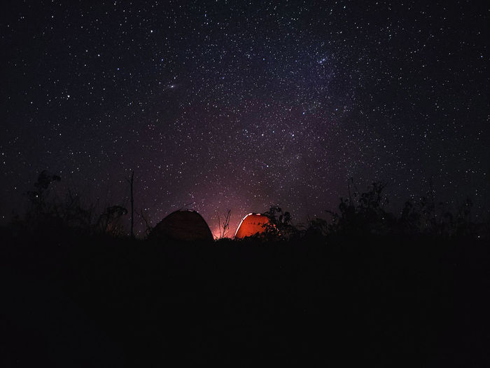 Beautiful campsite with a starry sky and campfire