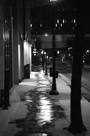 Snowing in downtown Brampton Canada Architecture Black And White Brampton Brmp Canada Headlight Monochrome Nigghtout No People Outdoors People Sky Snow Storefront Winter