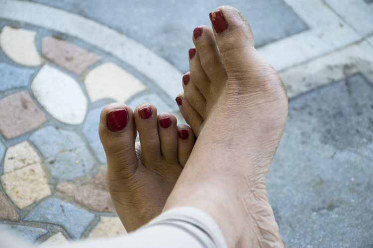 Low section of woman legs on footpath