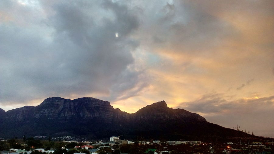 'A Stormy Sunset' Rain Weather Table Mountain Beautiful View Multi Colored Mountain Sunset Dramatic Sky Sky Cloud - Sky Landscape