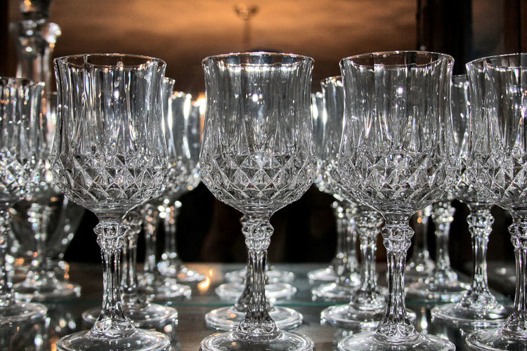 Close-up of crystal wineglasses on table