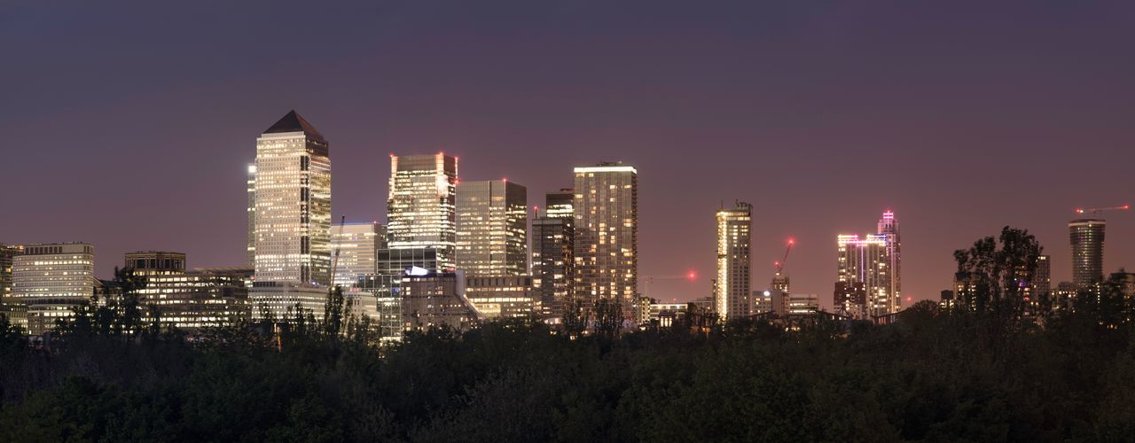 A panorama of Canary Wharf's skyline in East London taken from the top of Stave hill near Canada Water at night. I have removed the logos from the top of the towers to make this photo useful for non-editorial uses. Architecture Beautiful Canary Wharf Cityscape Construction Financial District  Gentrification Holiday London Panorama Reflection Sightseeing Thames Tourist View Amazing Background Buildings England Glass Night Skyscraper Window