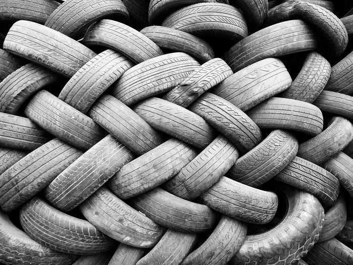 Piles of used tires shot in black and white. Black And White Photography Used Tires Pattern Pattern, Texture, Shape And Form Patterns Tires Horizontal No People Backgrounds Automotive Jakarta Indonesia