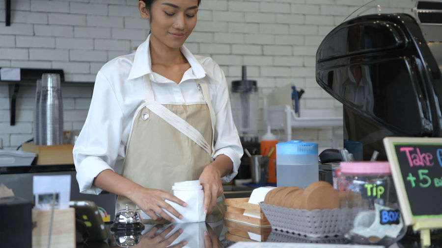 Female barista working at cafe