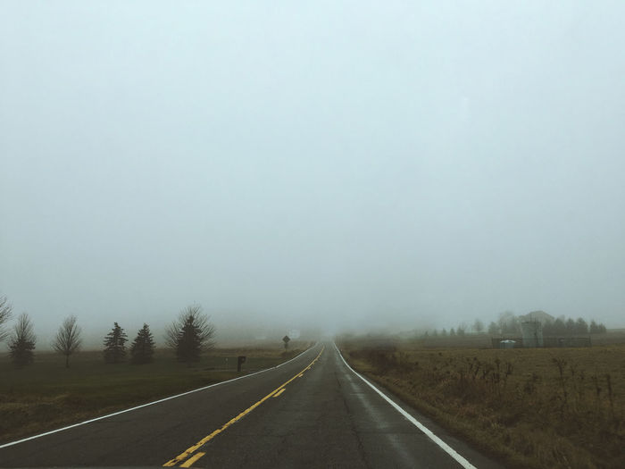 Foggy Drive Home Adventure Beauty In Nature Canon Canon Photography Day Exploring Exploring New Ground Fog Foggy Foggy Day Foggy Landscape Foggy Weather Landscape Nature No People Outdoors Remote Remote Location Road Roadtrip Sky The Way Forward Transportation VSCO Vscocam