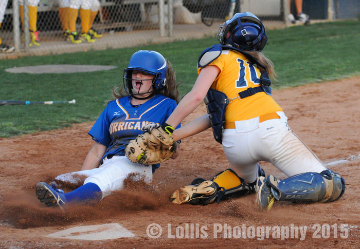 Wren Hurricanes Softball base runner is tagged out trying to score during a playoff game. Wren High School Playoffs Sports Photography