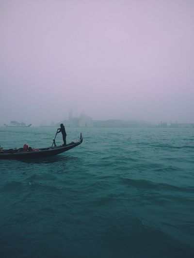 Stunning foggy day in Venice, Italy, gondola ride Water Beauty In Nature Real People Scenics Outdoors Tranquility Fog Horizon Over Water Day One Person Gondola Gondolier Venice, Italy Venezia Venice Veneto Laguna Sanmarco Foggy Day Foggy Winter Wintertime Foggy Weather Travel Destinations Traveling Place Of Heart Lost In The Landscape