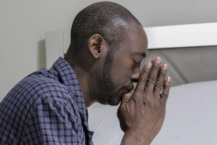 Side view of man praying