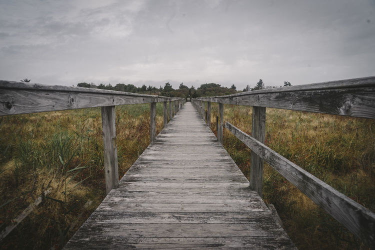 boardwalk Scenics - Nature Direction The Way Forward Sky Land Wood - Material Nature Plant No People Tranquility Cloud - Sky Railing Footpath Tranquil Scene Architecture Beauty In Nature Diminishing Perspective Day Built Structure Boardwalk Outdoors Wood Long