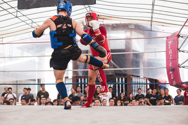 Kick (III) Sport Real People Group Of People Large Group Of People Combat Sport Combat Fighting Fight Men Crowd Clothing Motion Day Adult Lifestyles Competition Young Men Leisure Activity Athlete Young Adult Helmet Mid-air Effort Kick Kicking Muay Thai