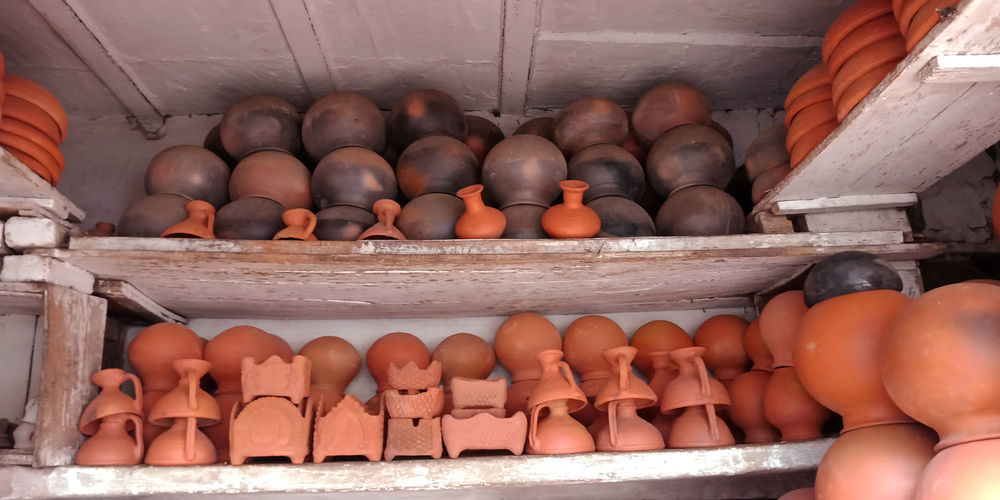 Clay pots for sale at market stall