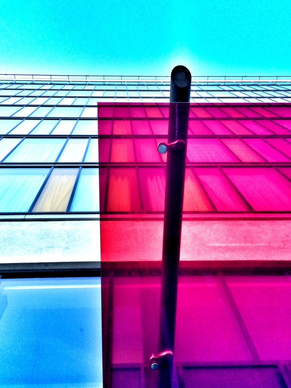 Low Angle View Of Open Window Of Glass Building Against Sky