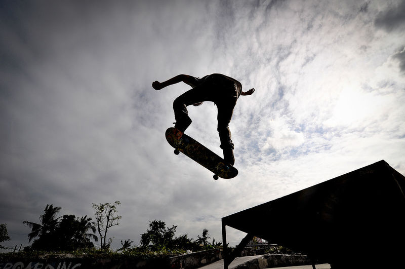Low angle view of man skateboarding at park