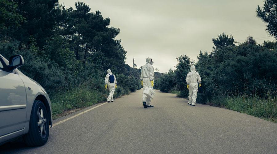 People in workwear walking on road