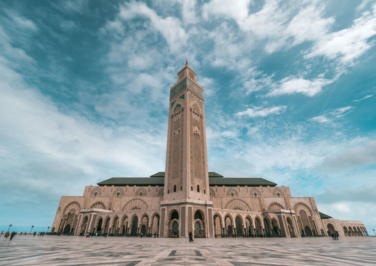 One of the biggest mosques in the world, Hassan II Mosque in Casablanca can hold up to 105,000 people at one time.🕌🇲🇦 It also has the highest minaret in the world at 210m high. Such a stunning piece of architecture inside and out. Architecture Casablanca EyeEmNewHere Hassan Hassan II Mosque Mina Morocco Olympus Architecture Building Building Exterior Built Structure Cloud - Sky Day History Low Angle View Mosque Nature Place Of Worship Religion Sky Tower Travel Destinations Wide Angle The Traveler - 2018 EyeEm Awards The Architect - 2018 EyeEm Awards