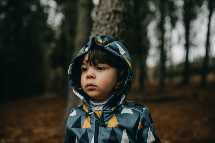 Portrait of boy in forest