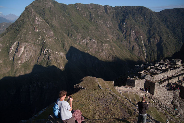 Tourists Photographing Machu Picchu By Mountains