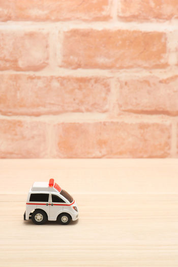 Aid Doctor  Emergency Hospital Paramedic Toy Car Transportation Accident Ambulance Brick Wall Car Copy Space Emergency Services Illness Injury Medical Miniature Rescue Sick Still Life Toy Treatment Urgency Urgent Care Vehicle