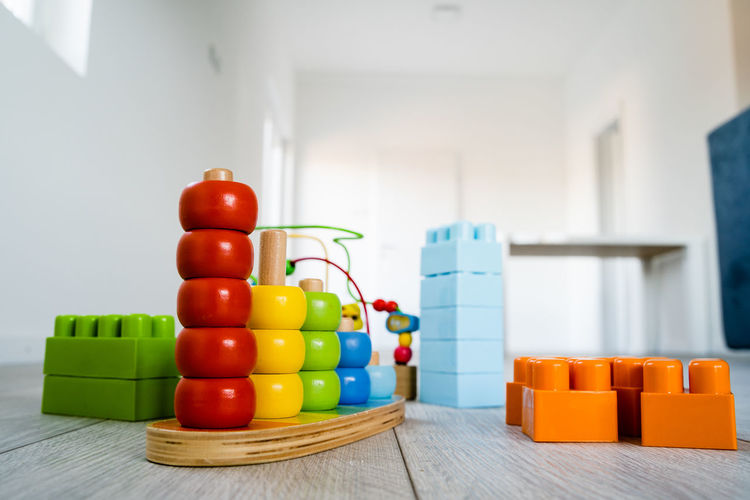 Multi Colored Indoors  Still Life Table Large Group Of Objects No People Toy Focus On Foreground Wood - Material Red Stack Close-up Plastic Container Home Interior Wellbeing Choice Toy Block Day Group Of Objects