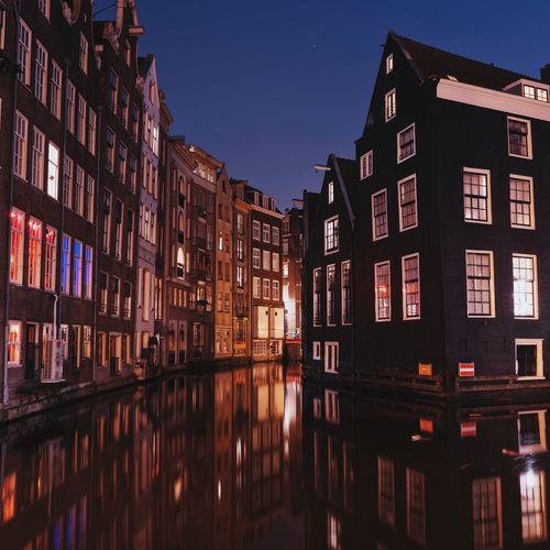 Amsterdam corners Building Exterior Amsterdam Holland Netherlands Architecture Reflection City Residential Building Night Water Traveling Outdoors No People EyeEm EyeEm Gallery Winter Travel Cityscape Photooftheday Travel Destinations EyeEm Best Shots Waterfront Travel Photography Eyeemphotography Reflection