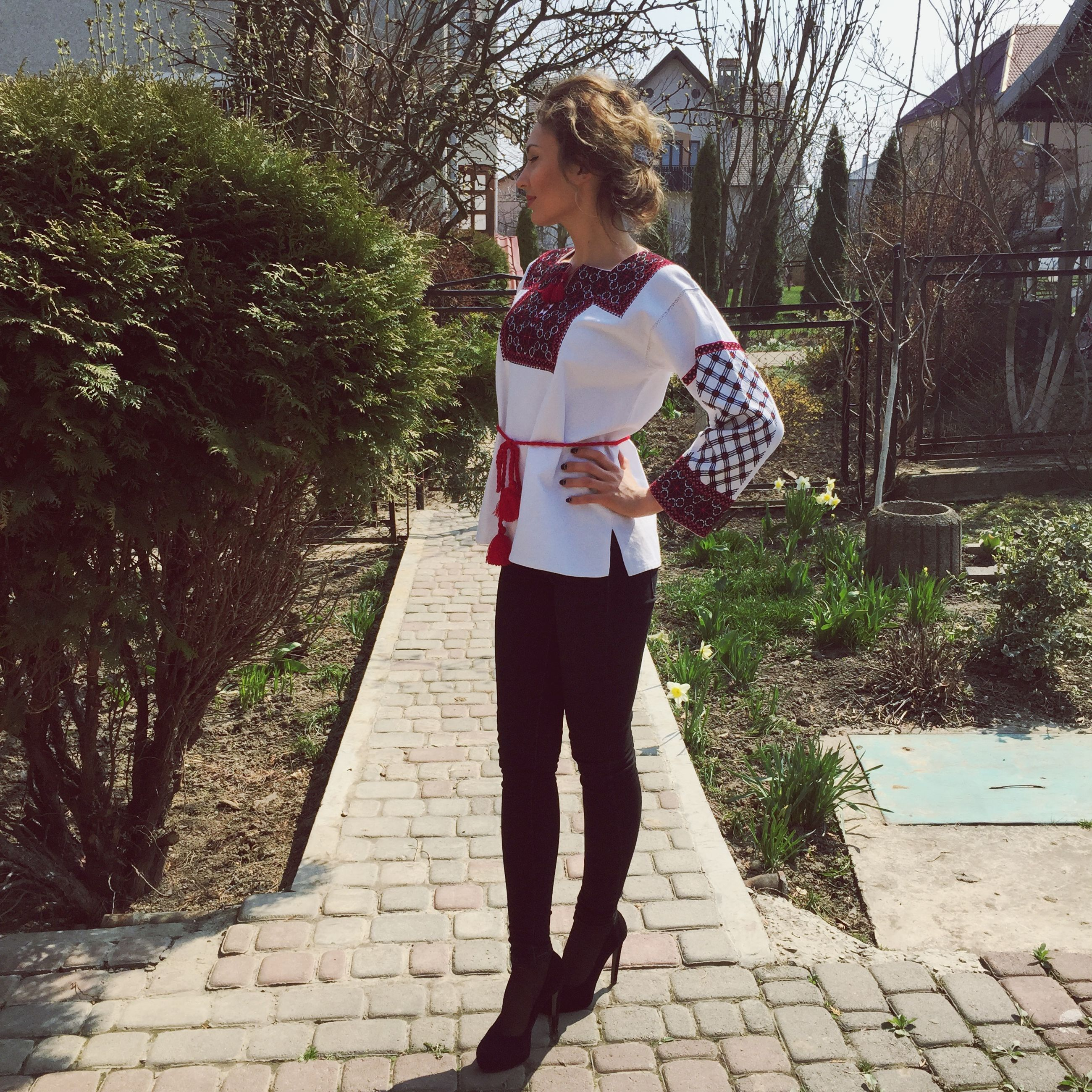 full length, lifestyles, casual clothing, person, leisure activity, young adult, young women, front view, childhood, standing, girls, tree, sunlight, footpath, elementary age, park - man made space, looking at camera, day