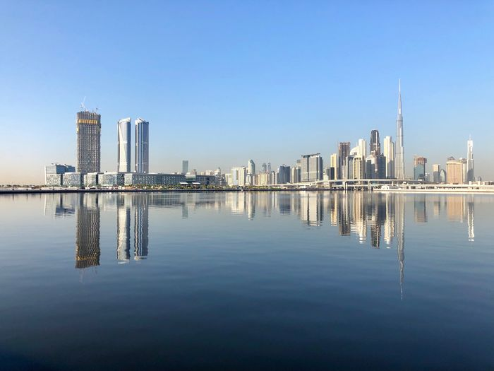 DUBAI downtown reflecting on the man-made water canal, United Arab Emirates Travel Destinations IPhone Photography Dubai IPhone X Architecture Water Building Exterior Built Structure Sky Building Office Building Exterior City Waterfront Reflection Skyscraper Urban Skyline Tall - High Landscape Clear Sky Modern