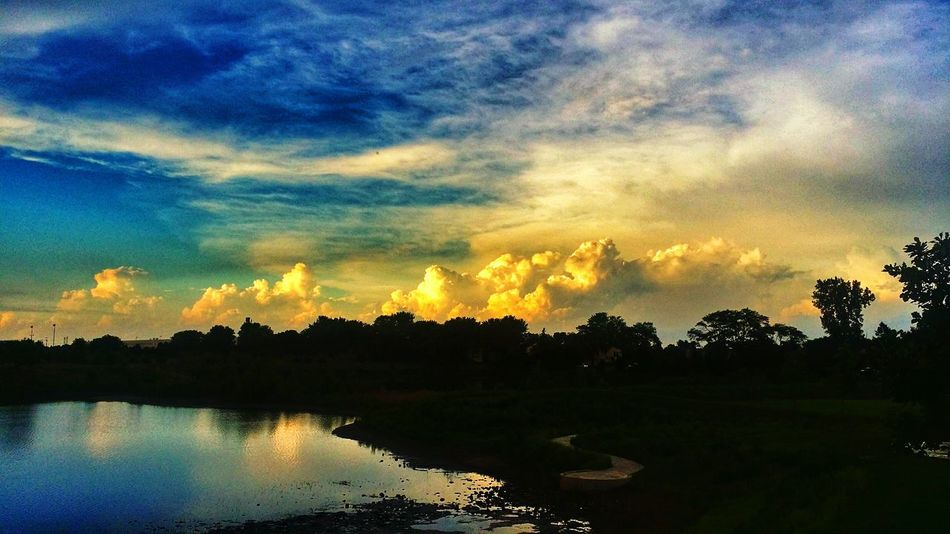 Enjoying Life Lake Sunset Colour Of Life Water Fluffy Clouds Eyeem Photo Ominous Sky Sky And Clouds