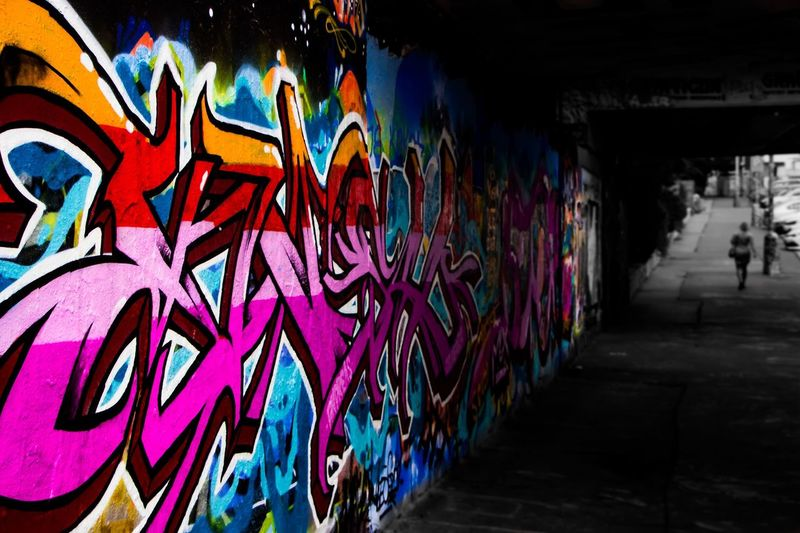 Graffiti Graffiti Wall - Building Feature Creativity Art And Craft Multi Colored Architecture Built Structure Street Art City Outdoors Paint Day Lifestyles Tunnel Text Street One Person Real People City Life