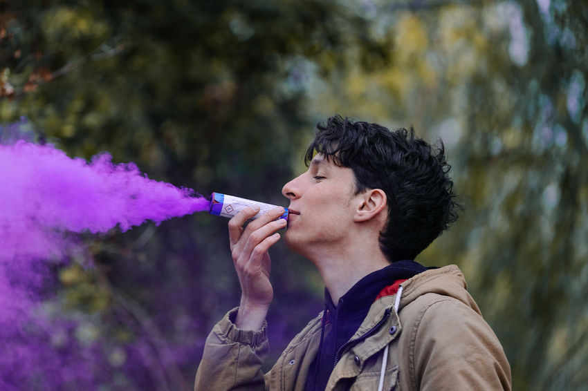 - with @matthias4 Smoke Smoke - Physical Structure Smoke Bombs Smoke Bomb Smoke Stack Purple One Person One Man Only Men Young Men Side View Headshot Tree Portrait Close-up Posing Emitting Entertainment