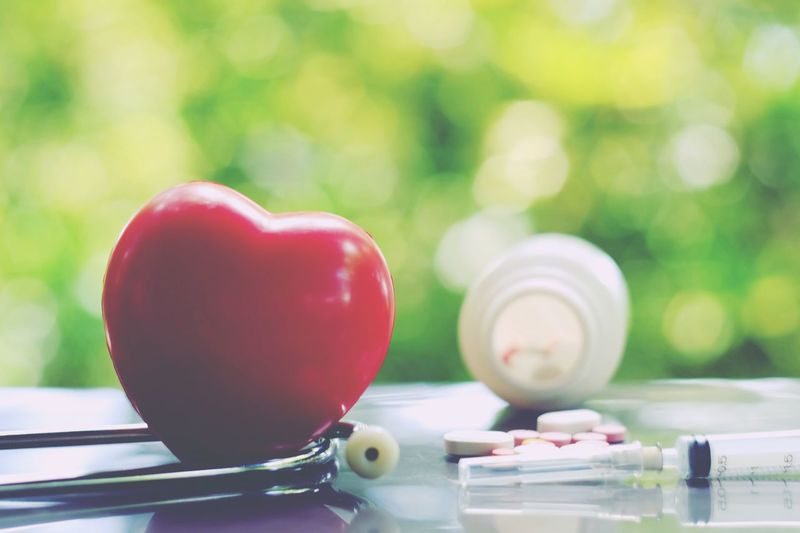 Red heart, statehscope, bottle of medicine table and syringe on table Healthcare Medicine Healthy Health Care Cure Stethoscope  Cardiac Cardiology Pain Medical Therapy Treatment Doctor  Disease Patient Technology Accident Medication Heartbeat Emergency Pulse Pressure Surgery Instrument
