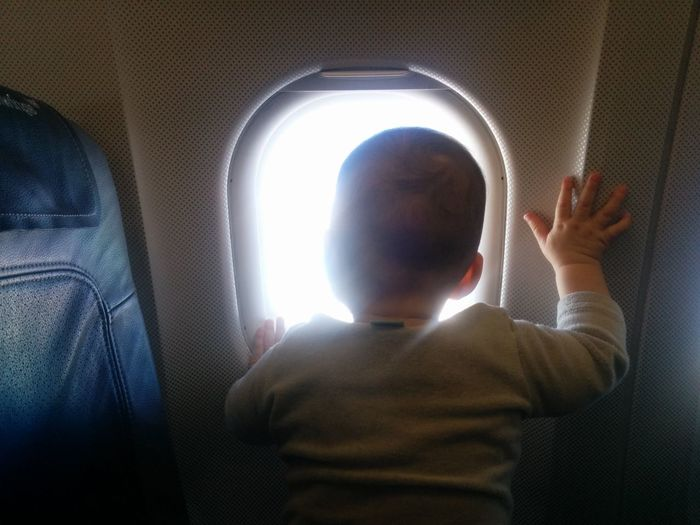 Air Airplane Baby Child Cropped Flight Light Person Standing Sun Unrecognizable Person Watching Window