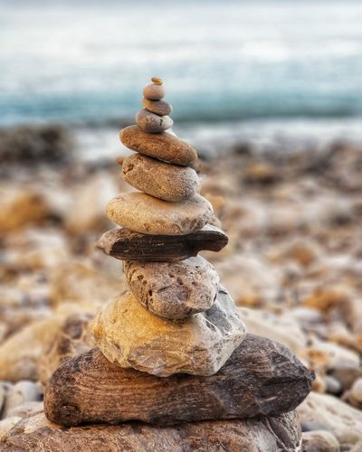 Close-up of stones stacked at beach