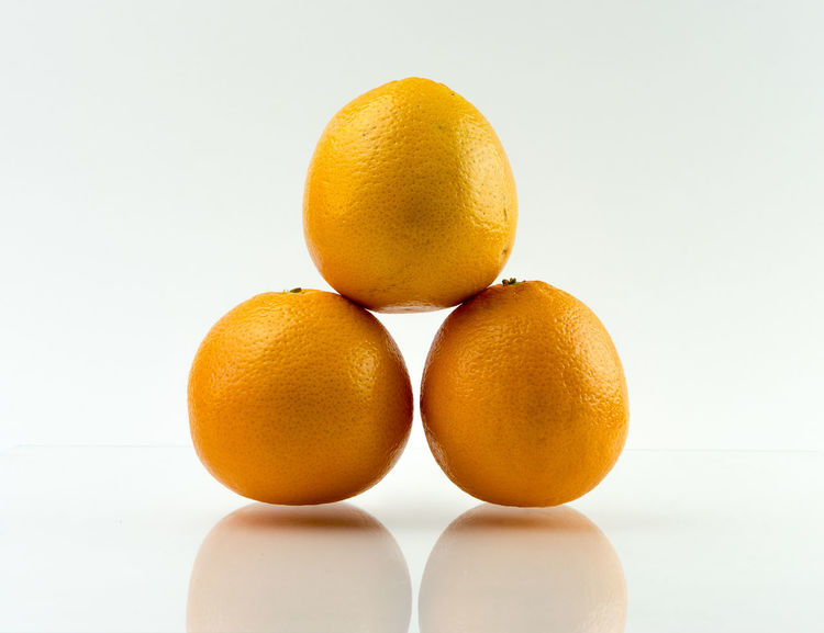 Citrus  Citrus Fruit Beautifully Organized Copy Space Food Food And Drink Freshness Fruit Fruits Healthy Eating Indoors  Orange Orange - Fruit Orange Color Oranges Organic Show Us Your Takeaway! Showcase April Still Life Studio Shot Table Three Vitamin White Background Yellow The Still Life Photographer - 2018 EyeEm Awards
