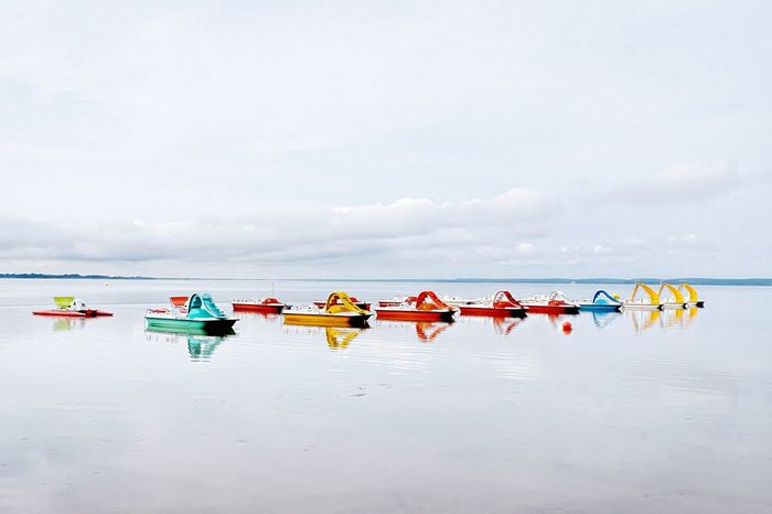 Pedal boats reflection Transportation Cloud Nautical Vessel Sky Boat Eye4photography  Beach EyeEm Best Shots Picoftheday Tranquility No People Mode Of Transport Group Of Objects Water Sea Calm Multi Colored Ocean Day Scenics Tranquility Solitude Waterfront Tranquil Scene Cloud - Sky