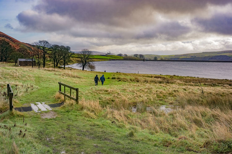 Embsay Moor, Yorkshire Dales. Walkers out on the moor in a wet, windy day. Embsay Animal Themes Beauty In Nature Cloud - Sky Day Field Grass Landscape Moorland Mountain Nature Outdoors Real People Scenics Sky Storm Cloud Tranquil Scene Tranquility Tree Water Yorkshire Dales