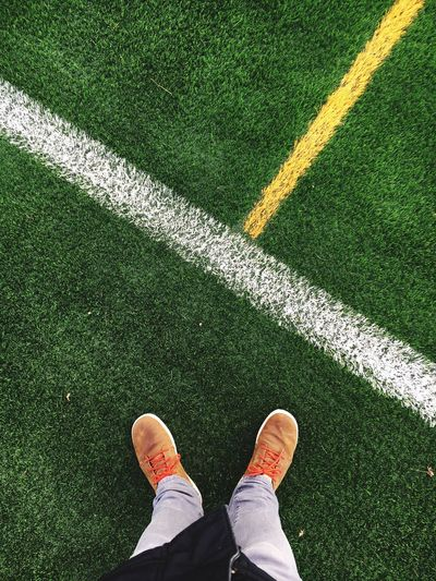 Low Section Of Man Standing By Markings On Playing Field