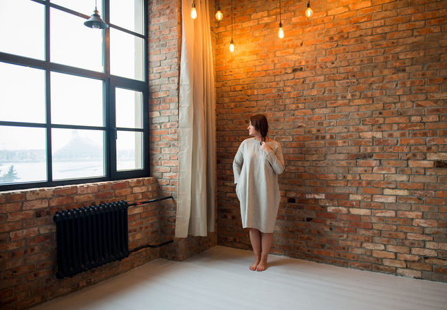 Fashion Lines Studio Adult Adults Only Brick Wall Clothes Clothing Day Full Length Indoors  Lifestyles Linen One Person One Woman Only Only Women People Real People Rear View Standing Studio Shot Style Summer Fashion Window Young Adult