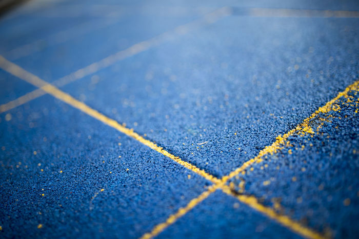 Competitive Sport Track And Field Stadium Sports Track Running Track Outdoors Full Frame Day Close-up Backgrounds No People Ground Level View Ground Blue
