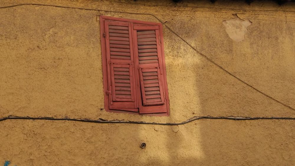just a window Cityscape Cracks And Shadows Old Town Old Wall Abandoned Architecture Building Exterior Built Structure City Photography Close-up Closed Closed Up Closed Window  Day Deserted House Low Angle View No People Old Buildings Old City Old Walls Outdoors Red Wall - Building Feature Window