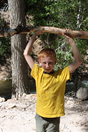 """He Man""...my boy at age ten..having a great time down by the waters edge!....no filter or edit... Adorable Arms Raised Boys Casual Clothing Childhood Climbing Day Elementary Age EyeEm Gallery EyeEm Team Front View Fun Leisure Activity Lifestyles Looking At Camera One Person Outdoors People Playing Portrait Real People Standing Tree Yellow Connected By Travel Lost In The Landscape"