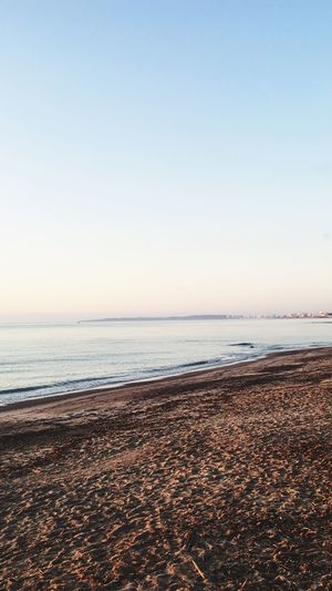 Balearic Islands Early Morning Sunrise Sea Water Beach Sky Land Scenics - Nature Beauty In Nature Tranquil Scene Horizon Over Water Tranquility Nature Sand No People Clear Sky Idyllic Outdoors Horizon Day Copy Space