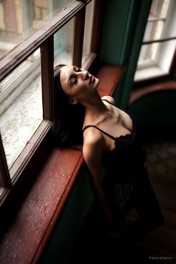 a.strelkovv EyeEm Selects Young Women Beautiful Woman Portrait Beauty Women City Females Window Leaning
