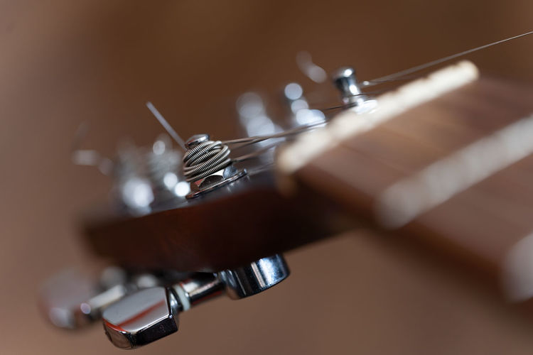 The Premium Collection Premium Collection Wood - Material Studio Shot Music Musical Instrument Close-up String Instrument Extreme Close-up Musical Instrument String Guitar Arts Culture And Entertainment String Tuning Pegs