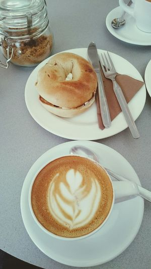 Close-Up Of Coffee Served With Bread On Table