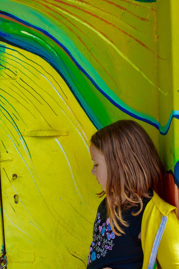 Profile Picture Profile Shot One Little Girl Beautiful Woman Portrait Photography Yellow Color Multi Colored Young Women Yellow Women Backgrounds Close-up Yellow Background Street Art Mural Graffiti Art Scribble Light Painting