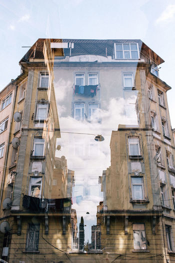 Double Exposure Apartment Architecture Building Building Exterior Built Structure City Cloud - Sky Day Digital Composite Façade Low Angle View Nature No People Outdoors Reflection Residential District Sign Sky Smoke - Physical Structure Window